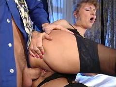 Guy fucking cool ass of milf in stockings on table