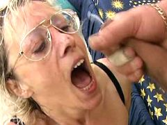 Granny gets cum on tongue