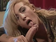 Blond tranny fucking w tattooed guy right on table