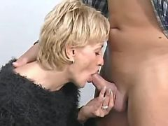 Mature blond secretary throats hard cock in office