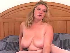 Busty mature sucks cock