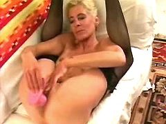 Blonde mature in stockings plays with pink dildo