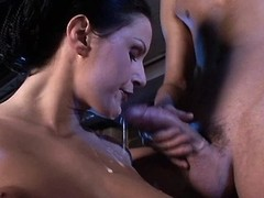 Luxurious brunette sucks cocks of two lewd workers