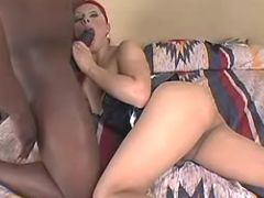 Redhead shemale throats huge cock